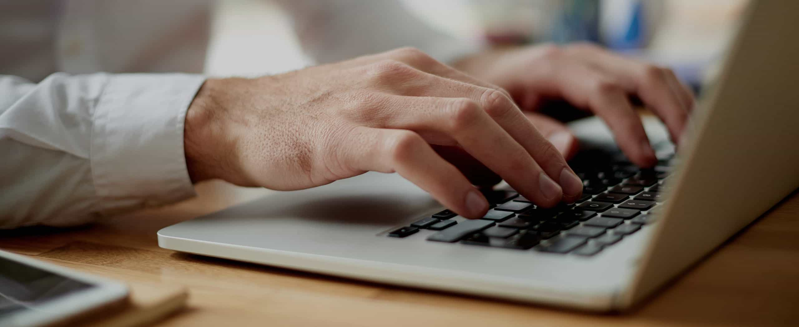 Image of person using a laptop